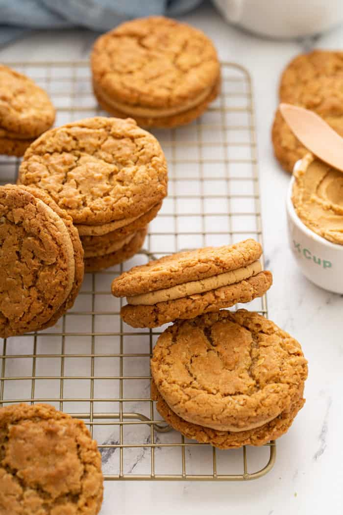 Biscoff sandwich cookies scattered in a wire cooling rack