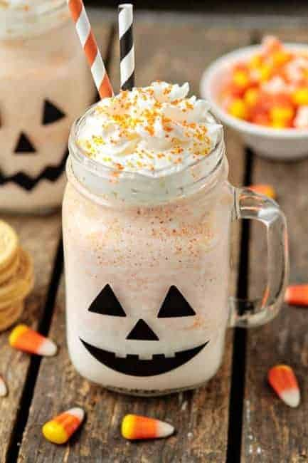 Candy Corn Oreos and vanilla ice cream combine to create a deliciously festive Halloween Oreo Milkshake.