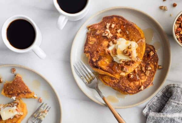 Pumpkin Pancakes are loaded with delicious fall flavor. These are perfect for Thanksgiving morning!