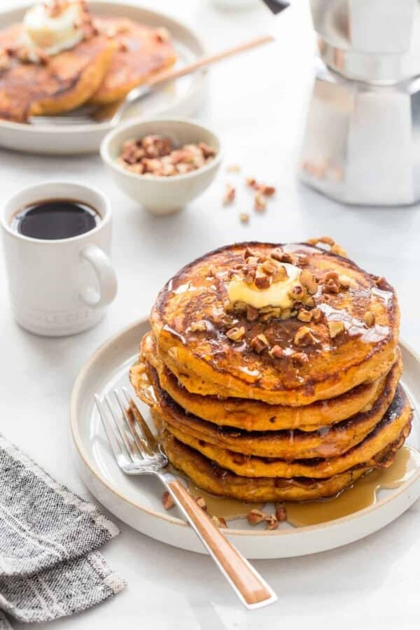 Pumpkin Pancakes are loaded with delicious fall flavor. If you're looking for the perfect Thanksgiving breakfast or brunch, you just found it!