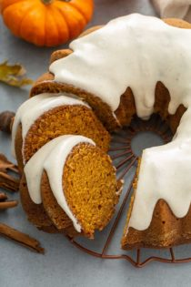 Sliced pumpkin bundt cake on a wire rack