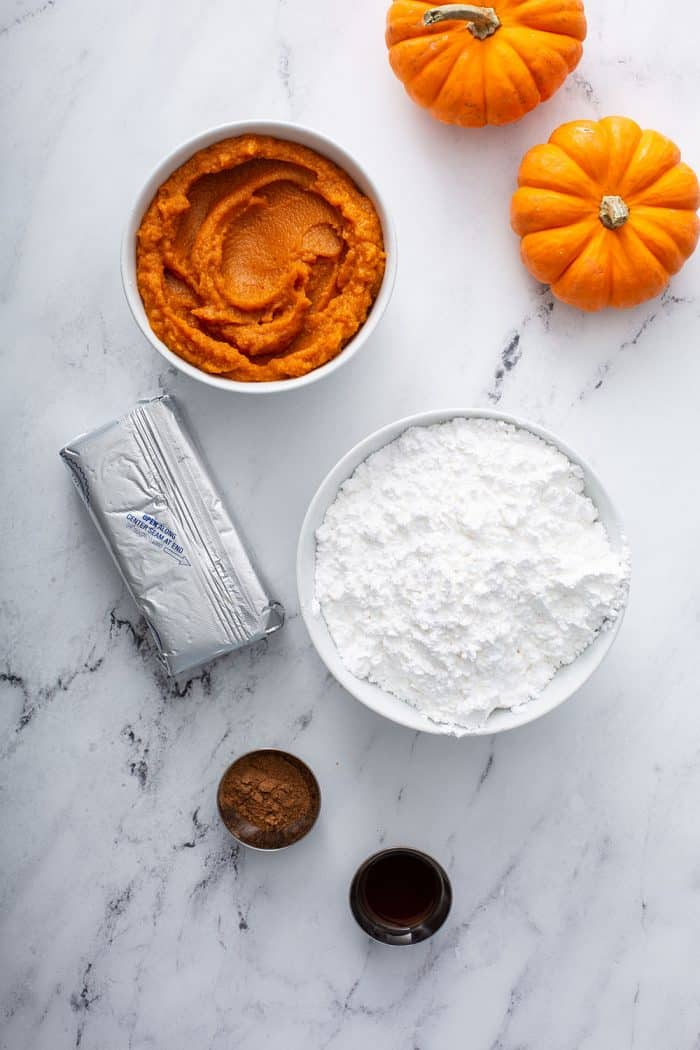 Ingredients for pumpkin dip on a marble countertop