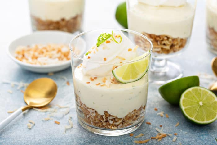 Close up of individual key lime cheesecakes with graham cracker crumble