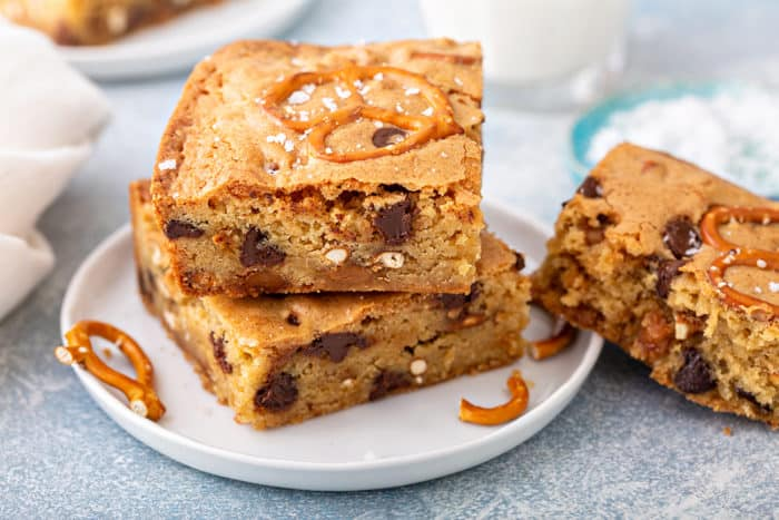 Stacked salted caramel blondies on a white plate