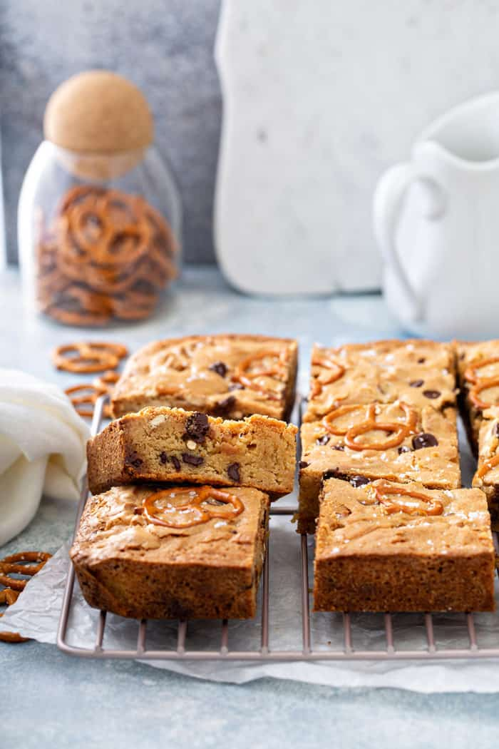 Sliced salted caramel blondies cooling on a wire rack