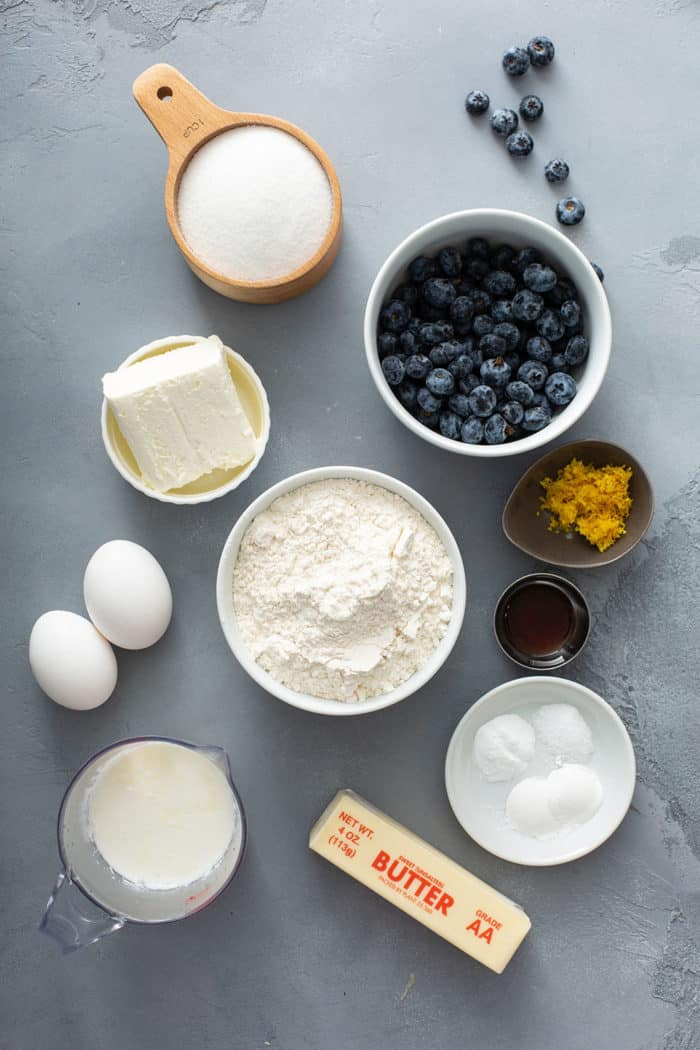 Ingredients for lemon blueberry bread on a gray counter