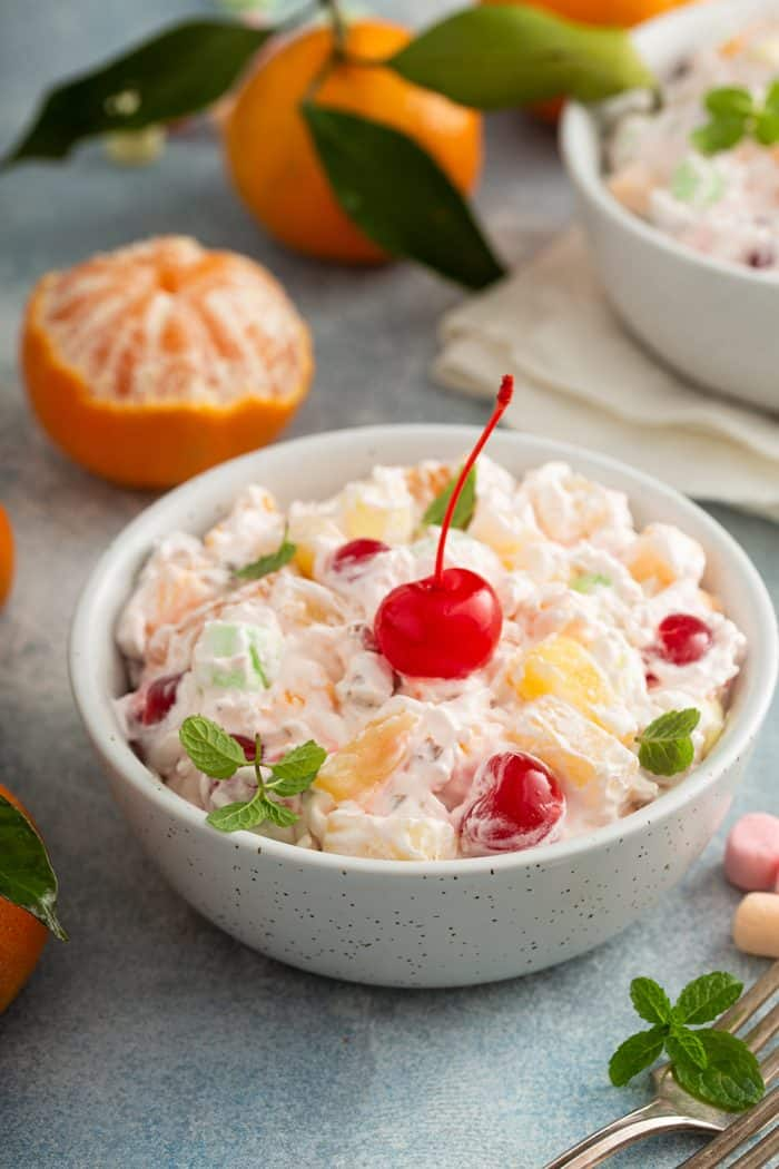 Close up of ambrosia salad in a small white bowl