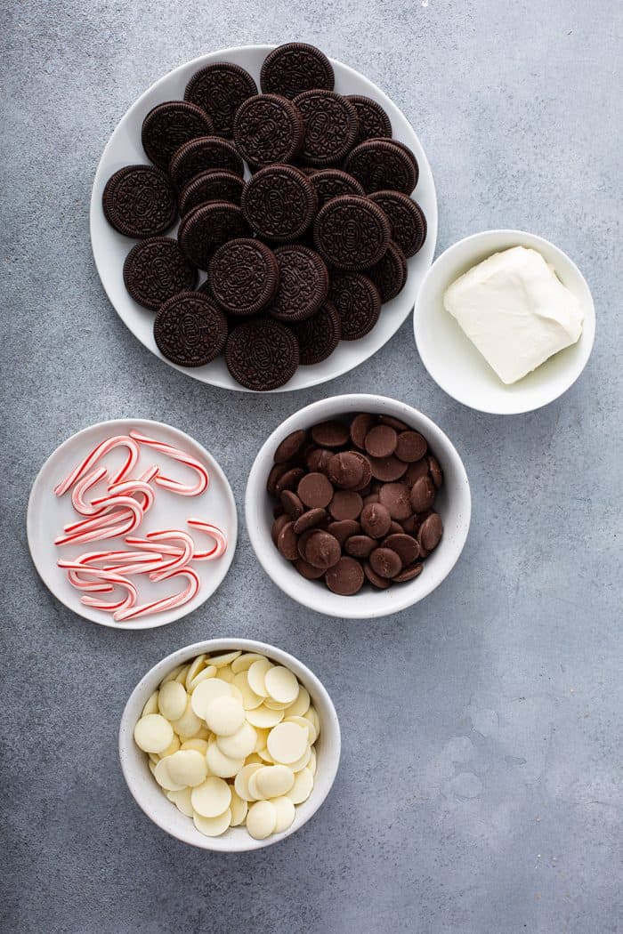 Ingredients for peppermint oreo balls arranged on a gray counter