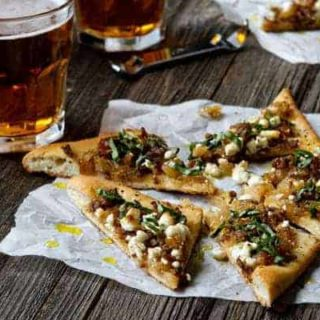 Homemade Pizza with Sausage, Caramelized Onions and Goat Cheese