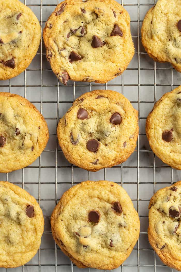 Chocolate Chip Pudding Cookies lined up on a wire rack to cool
