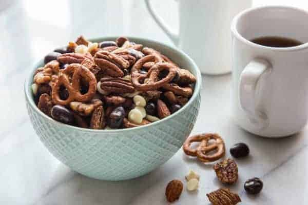 Almonds, walnuts and pecans star in this Espresso Snack Mix. Made decadent with oatmeal squares, pretzels, chocolate covered espresso beans, and white chocolate chips, it's a tasty treat that's heart healthy too!