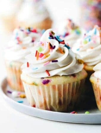 Frosted funfetti cupcakes on a platter