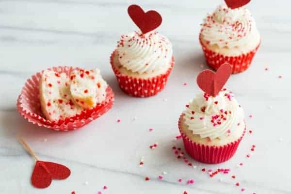 Delicious homemade funfetti cupcakes are so easy to make and perfect for just about any occasion. These cuties are dressed up for Valentine's Day, but they'd be just as cute with green sprinkles for St. Patrick's Day!
