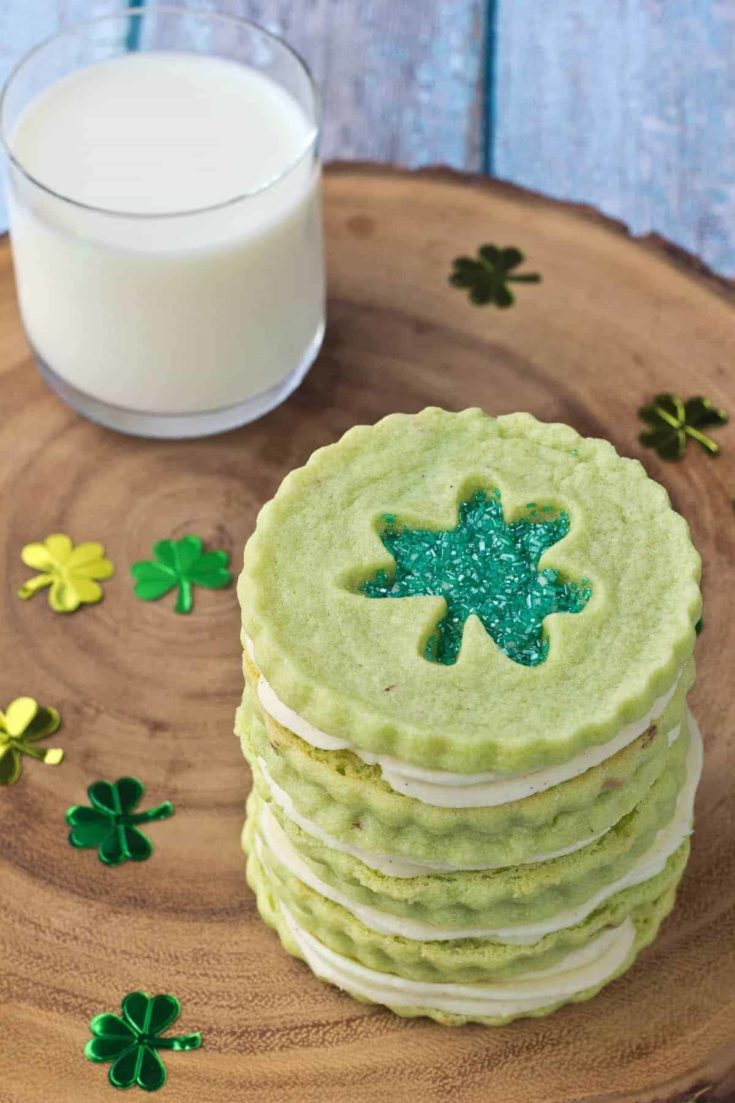 Pistachio Pudding Linzer Cookies couldn't be more adorable or perfect for St. Patrick's Day. Don't skimp on the sprinkles!