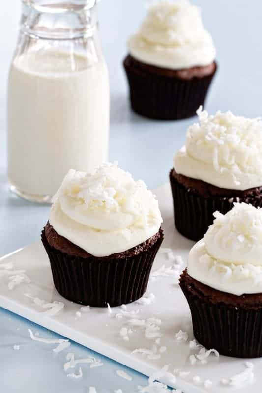 Quick and easy Almond Joy Cupcakes are made with a doctored up cake mix and topped with fluffy buttercream and sweet coconut.