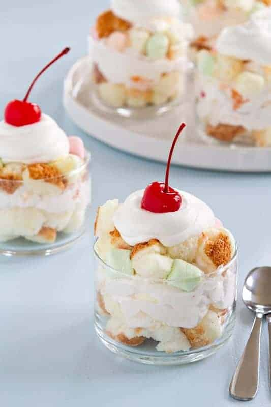 Layers of angel food cake and ambrosia salad are topped with fruity, miniature Campfire® marshmallows. These ambrosia trifles are sure to be the star of your Easter dessert table.