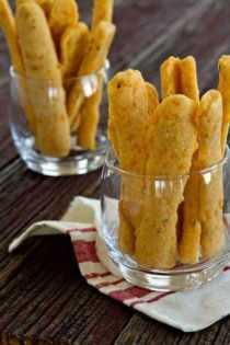 Cheese straws come together in a snap and are just perfect for just about any party. Garlic and rosemary give them a little unexpected kick.