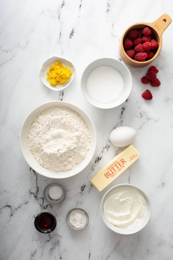 Lemon raspberry scone ingredients on a marble surface