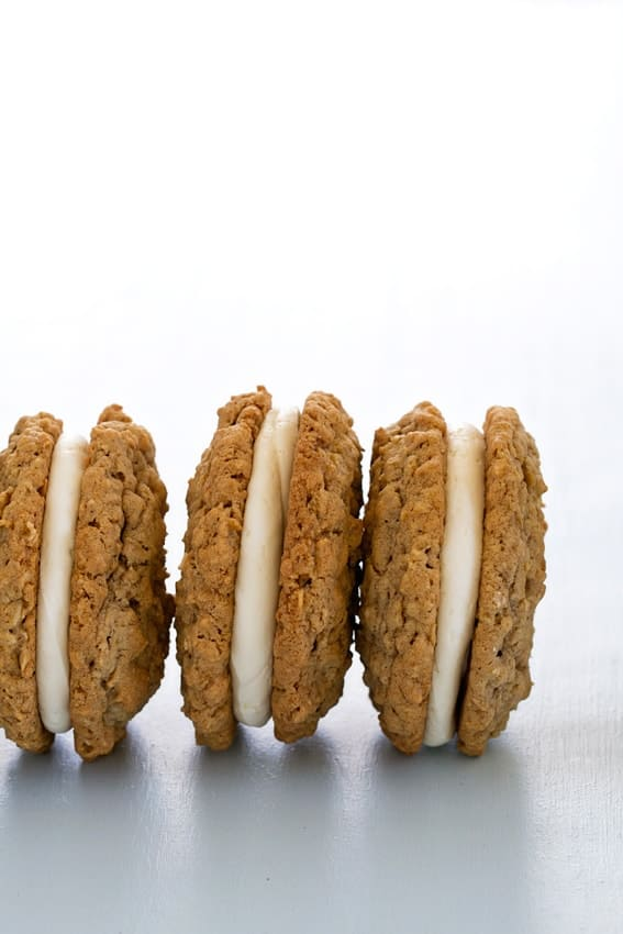 Giant Oatmeal Cream Pies sandwich buttercream between two chewy oatmeal cookies. Total decadence.