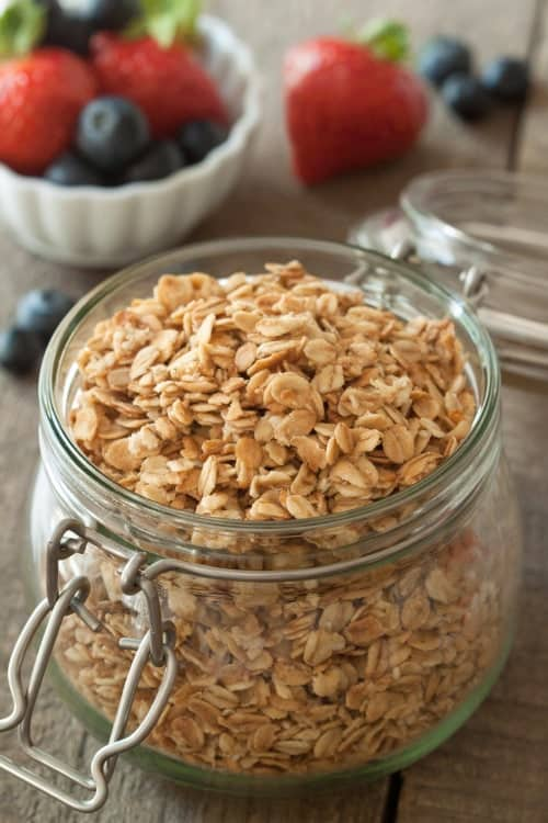Simple gluten-free granola pairs perfectly with yogurt and berries to create a delicious breakfast parfait.