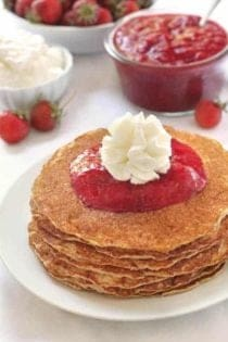 Gluten-Free Pancakes with homemade strawberry sauce and whipped cream. So good!