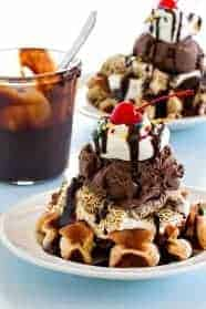 Mini waffles are topped with ice cream, toasted marshmallows and all the fixings to create the most delicious sundae.