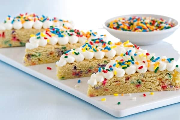 Sugar Cookie Bars Funfetti Sugar Coookie Bars are exactly the dessert to feed a crowd! Just look  all those sprinkles!