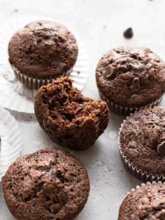 Chocolate zucchini muffin with a bite taken out of it