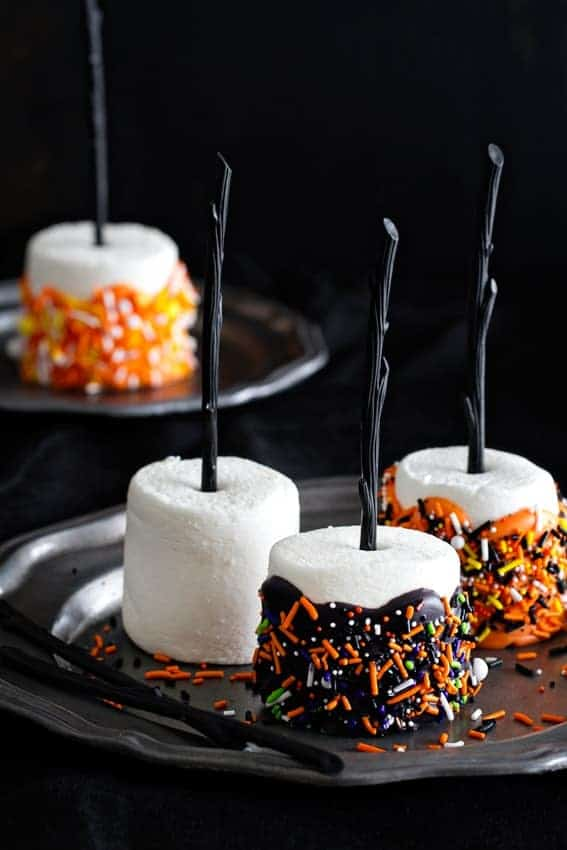 Halloween Marshmallow Pops are the handheld treat you want at your Halloween party. Colorful and delicious.