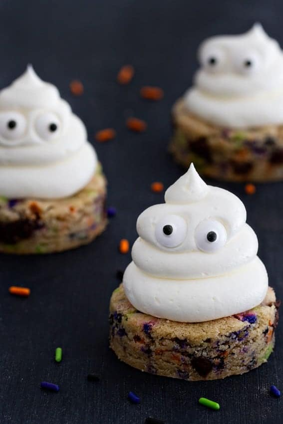 Halloween Chocolate Chip Cookies are spread with sweetly smooth buttercream. The sprinkles add the extra happy touch.