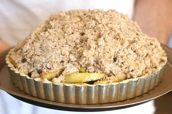 This gluten-free apple tart has a thick crumb topping and can also be made with traditional all-purpose flour.