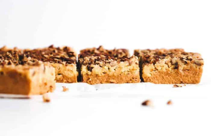 horizontal image of sliced pumpkin crunch cake with crumbs in foreground