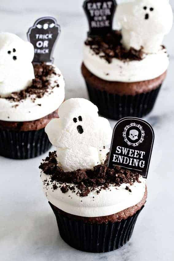 Dirt Pudding Cupcakes will make your Halloween buffet table more adorable than ever. What's better than dirt pudding? Serving it up in a chocolate cupcake.