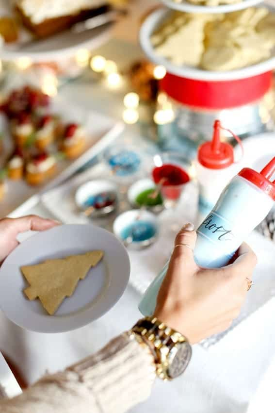 Simple tips and tricks for hosting a DIY cookie decorating party! Get ready to have a merry time!