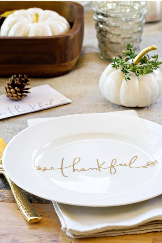 A simple yet elegant Thanksgiving tablescape with painted white pumpkins and gold accents. So pretty.