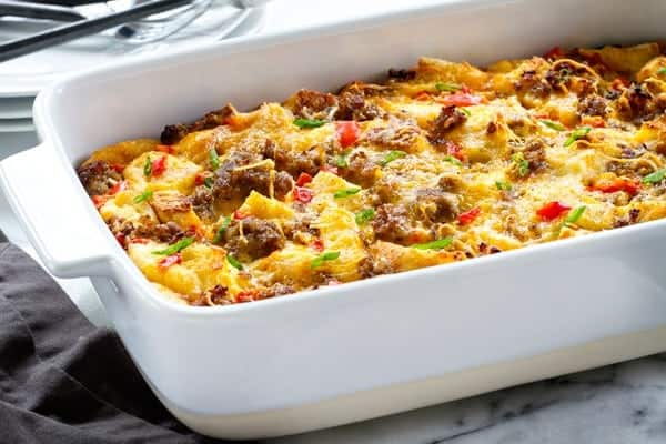 Make-Ahead Breakfast Casserole is loaded with sausage, cheese, bread, and eggs. It's the perfect overnight breakfast for Christmas morning!