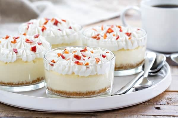 Maple Bacon Cheesecakes are sweet, salty and topped with a dollop of whipped cream and candied bacon. So darn good!