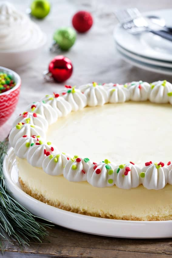 Sugar Cookie Cheesecake is going to be your new favorite holiday dessert. Festive sprinkles make it extra special!