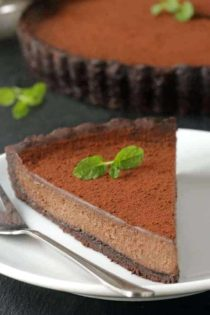 Mint Chocolate Tart has a creamy chocolate filling and homemade chocolate cookie crust. So delicious. Recipe includes a gluten-free option.