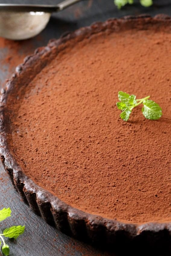 Mint Chocolate Tart is rich, decadent and full of mint flavor. So great for the holidays! Recipe includes a gluten-free option.
