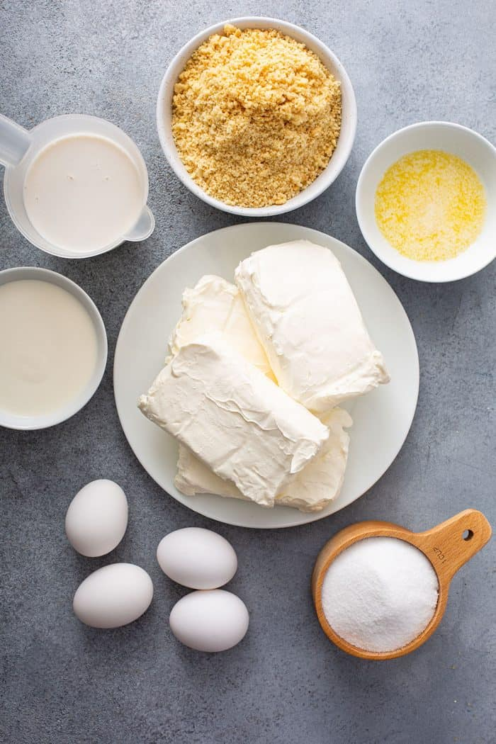 Ingredients for sugar cookie cheesecake arranged on a countertop