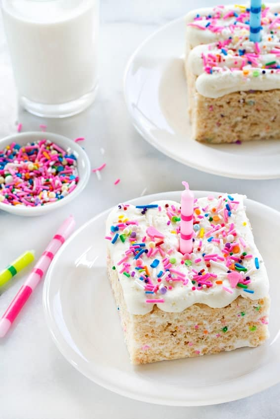 Birthday Marshmallow Cereal Treats are over-the-top in the best way possible! Gooey marshmallows, buttercream frosting and loads of sprinkles!