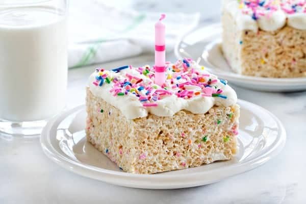 Birthday Marshmallow Cereal Treats are loaded with all the good stuff! Marshmallows, buttercream frosting and sprinkles! Who needs cake when you can have these?