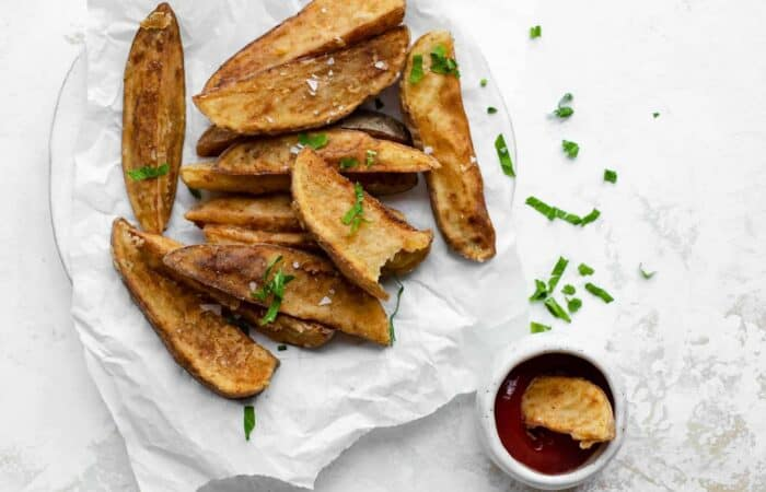 Jo Jo Potato wedges on parchment paper served with ketchup