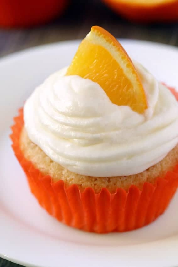 Orange Creamsicle Cupcakes of brimming with bright orange flavor and topped with cream cheese frosting. So delicious! Recipe contains a gluten-free option.