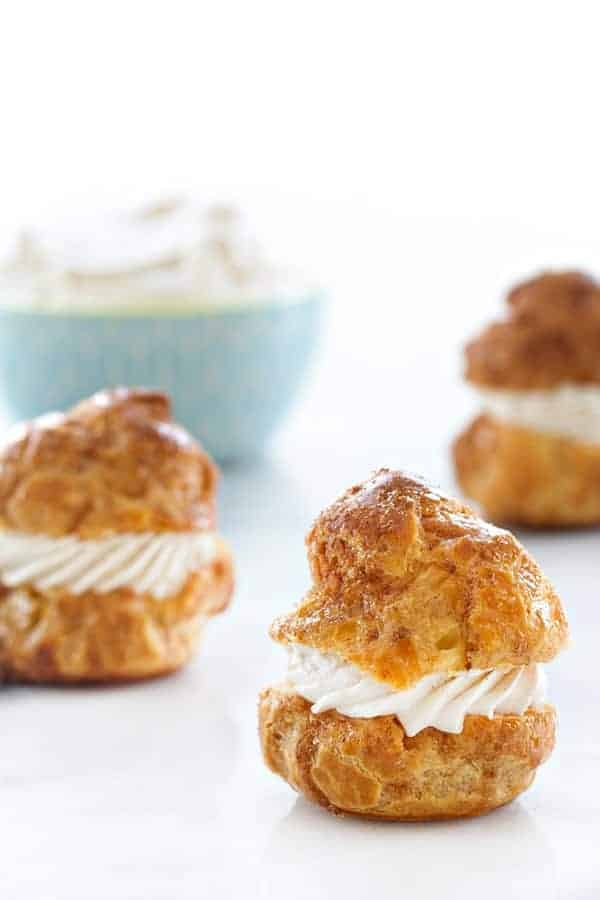 Churro Cream Puffs are filled with a sweet cinnamon whipped cream. Truly amazing.