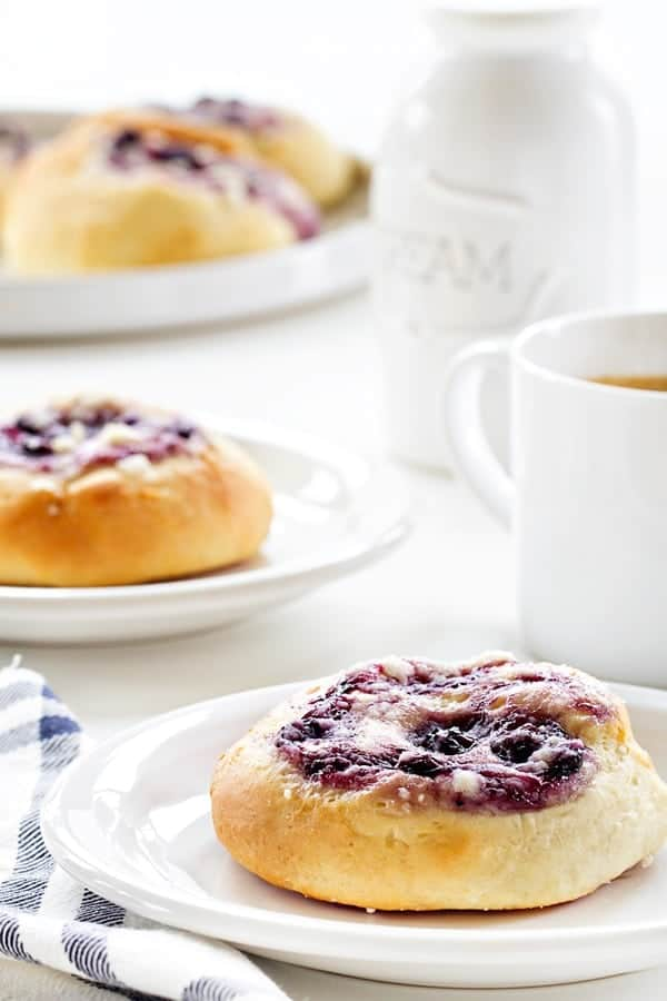 Blueberry Cream Cheese Kolaches have a soft fluffy dough that holds a sweet filling. The pastry of your dreams!