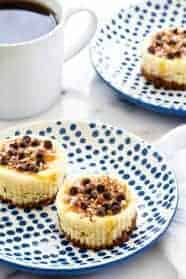Turtle Cheesecake Cookie Cups are bite sized indulgences. You won't be able to stop at one!