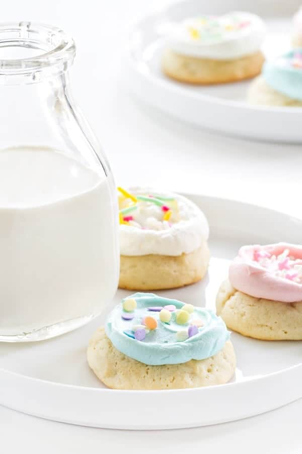 Soft Sugar Cookies are frosted with buttercream. Heaven in a cookie!
