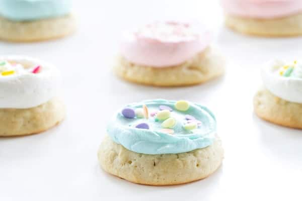 Soft Sugar Cookies are topped with fun pastel sprinkles. A cookie that brings happy smiles!